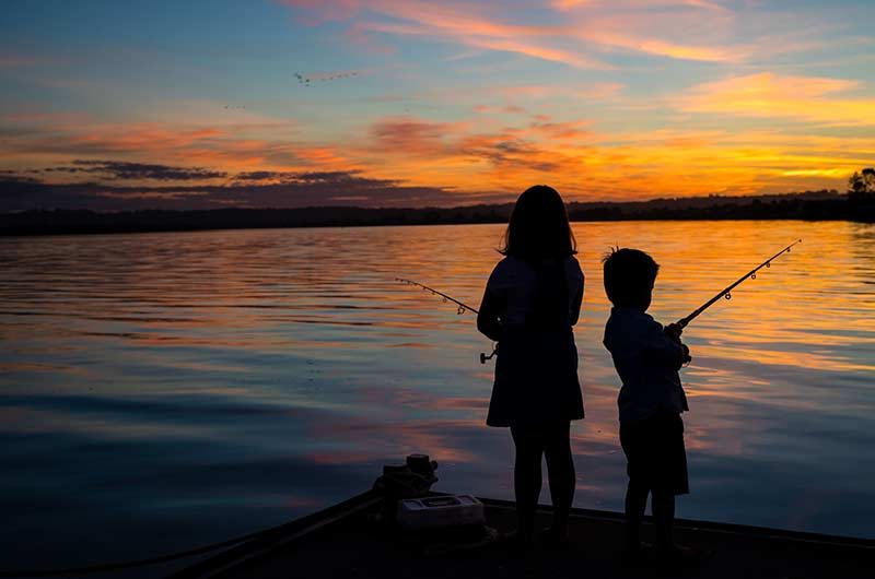 girla nd boy fishing from the pier, ballina